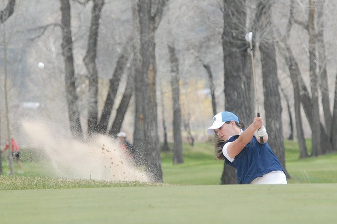 Sophomore Sam Fox swings from a bunker during Tuesday's Moffat County High School girls golf tournament at Yampa Valley Golf Course. Fox shot 124 on her home course.