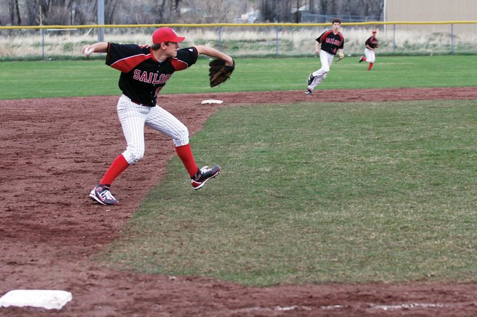 Tyler Brown makes a throw to first base after fielding a ground ball during a varsity baseball game against Moffat County High School on Tuesday at Craig Middle School. The Sailors had to play their home game on away turf because of a wet field in Steamboat. The Sailors lost, 9-3.