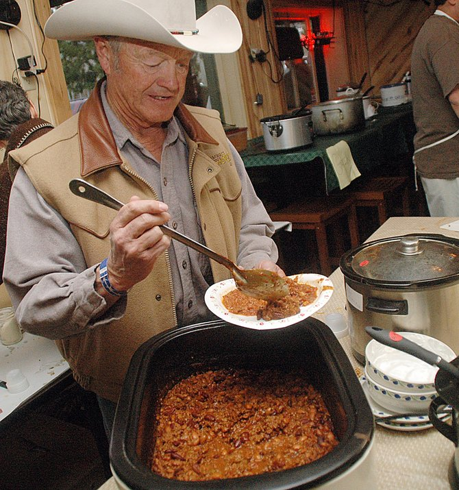 Ray Heid loads up a plate at last year's Great North Routt Chili Cook-off. This year's event is from 3 to 6 p.m. Sunday at the Glen Eden Family Restaurant & Tavern.