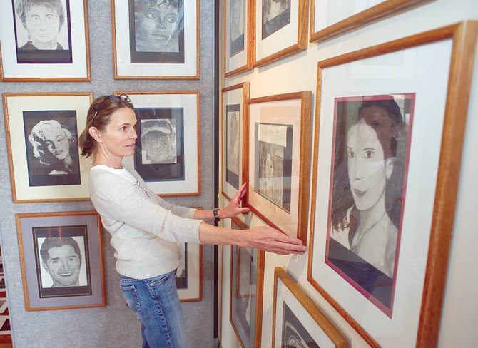 Volunteer Janet Borden helps hang the Routt County Youth Art Show at the Depot Art Center. Students from area elementary, middle and high schools contributed nearly 400 pieces to the show that opens Friday with a free reception from 5 to 8 p.m.