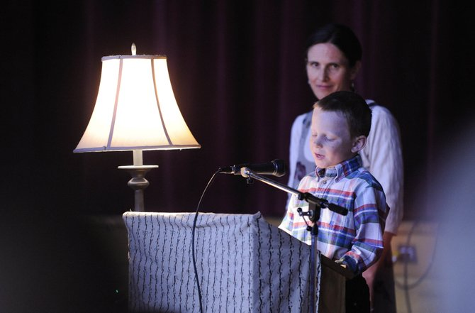 South Routt Elementary School literacy teacher Kate Krautkramer listens to first grader Kody Logan read a poem Wednesday evening at the school.