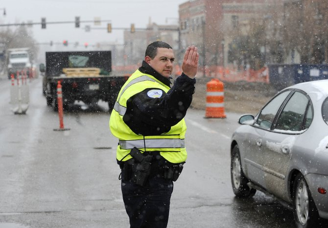 Steamboat Springs police officer Nick Moore directs traffic Friday at Seventh Street and Lincoln Avenue. The state will pay at least $70,000 for expanded traffic control during construction downtown.