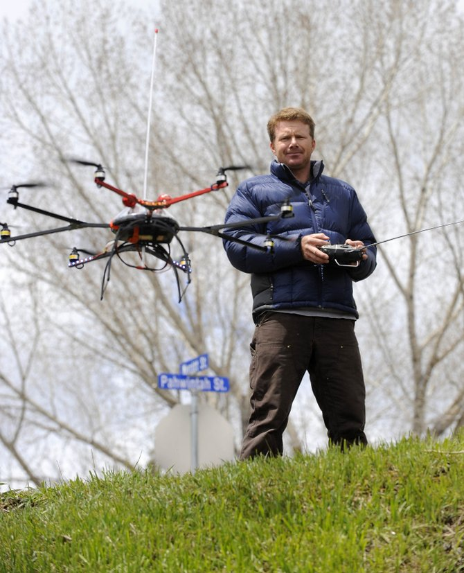 Cedar Beauregard flies his octo-copter, the newest edition to his aerial photography fleet.