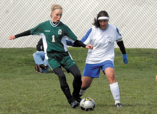 Araceli Rodriguez, right, battles with a Delta defender Saturday at Woodbury Sports Complex. Rodriguez would score the only goal for Moffat County High