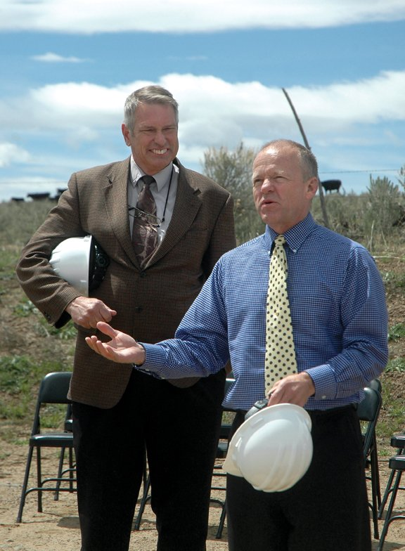 John Boyd, Colorado Northwestern Community College president, left, and Gene Bilodeau, CNCC vice president of administration, speak before a groundbreaking at the college's new campus site Monday afternoon. The new campus, including an academic building, a career/technical building and a residence hall, is slated to open in the fall of 2011.