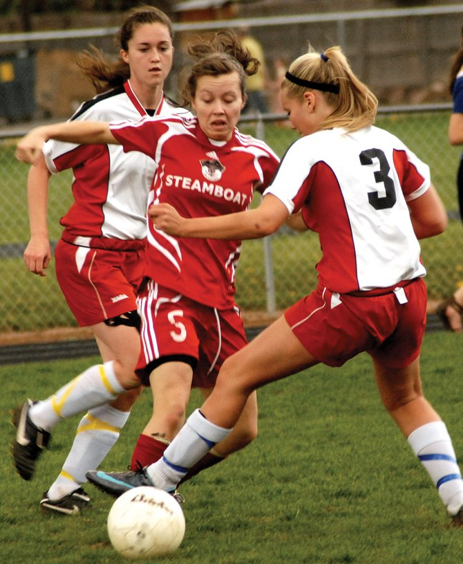 Steamboat Springs High Schools Haley Brookshire battles for the ball against Glenwood Springs High Schools Leah Mansfield, right, and Allie Rippy in Wednesdays game in Glenwood Springs. The Sailors lost, 3-1.
