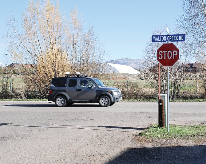 Eastbound cars pass on Walton Creek Road on Wednesday from the perspective of a motorist approaching the intersection from Chinook Lane. An application to the city for a subdivision preliminary plat approval would create an extension of Chinook across Walton Creek Road where Yampa Valley Medical Center is considering creating a senior living campus. The Tennis Center at Steamboat Springs is visible in the background.