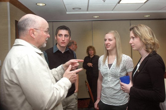 Joe Petrone, left, the Moffat County School District superintendent, speaks with MCHS students Slade Gurr, Mandi Ellgen and April Etheridge at a reception Friday at the Hampton Inn. In a culmination of the El Pomar Youth in Community Service program, 11 MCHS students presented $5,050 in grants to local organizations.