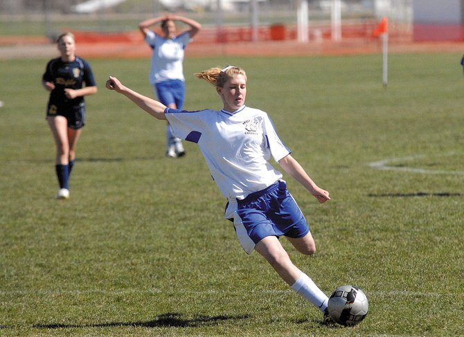 Freshman Kelsie Pomeroy kicks the ball in the first half of the Moffat County High School girls varsity soccer game Friday against Rifle at home. MCHS won, 2-1, in overtime to win its fifth game of the season.
