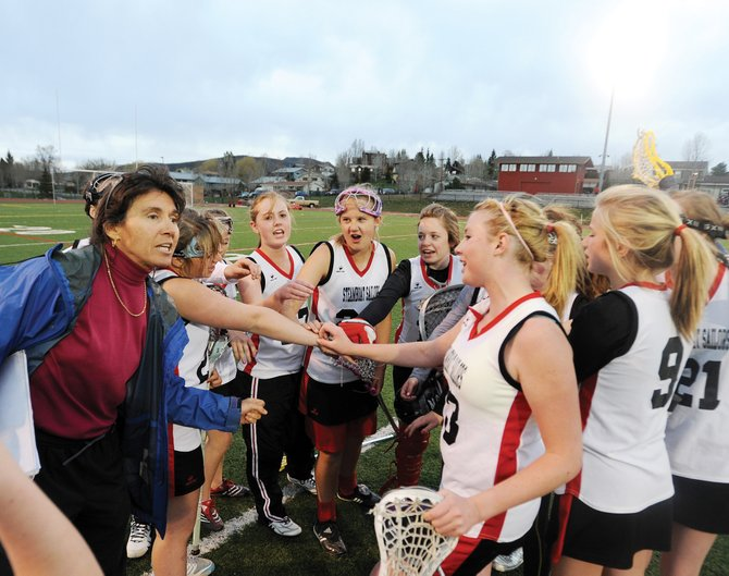 Steamboat Springs girls lacrosse coach Betsy Frick leads her junior varsity team in a cheer after Wednesday evening's season finale game in Steamboat Springs. The squad played only four games this year but was the only high school girls lacrosse team available in Steamboat. Frick hopes to grow the program in the coming years.