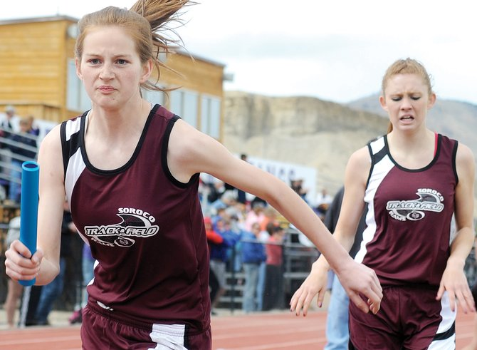 Soroco freshman Josie Rossi takes the baton from teammate Micaela Meyer on Saturday at the Western Slope League track meet in Kremmling. The two freshman have been key in Soroco's ability to maintain a strong girls relay presence.