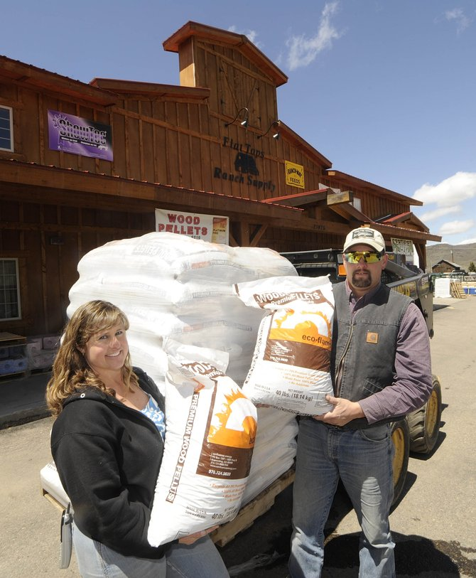 Jules, right, and Wendy Palyo, owners of Flat Tops Ranch Supply in Phippsburg, say the increasing demand for wood pellets as a heating source in South Routt County led to nearly 400 tons of pellets being sold this past winter.