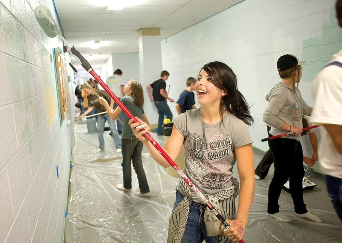 Hayden eighth-grader Belle Mazzola paints a wall in one of the middle school's hallways along with classmates Tuesday as part of Global Youth Service Day, which was organized by the school-based mentor program Partners in Routt County. Organizers hope the program will empower youths to participate in service activities in their communities. Each Routt County middle school has projects planned as part of Global Youth Service Day.