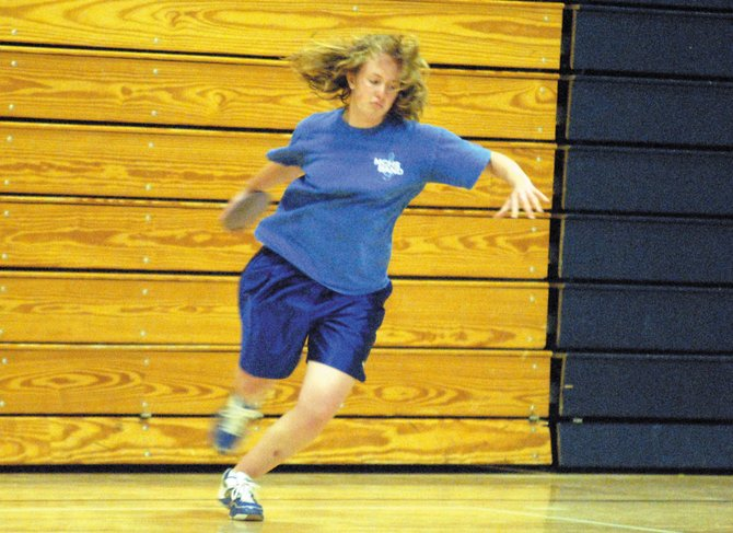 Freshman Nicole Sullenberger throws a rubber discus Wednesday in the Moffat County High School gymnasium. The MCHS varsity track and field teams will compete today in Grand Junction during the Western Slope League Championships.