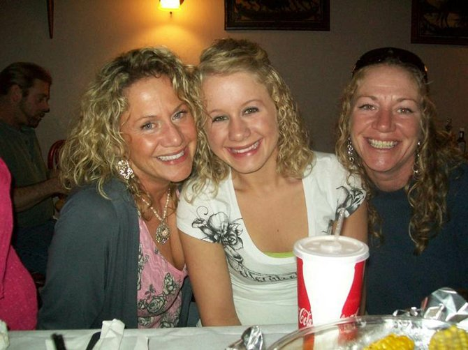 Kimberly Fournier, right, is pictured in this undated photo with her sister Lori Fournier, left, and Lori's daughter, Sydney.