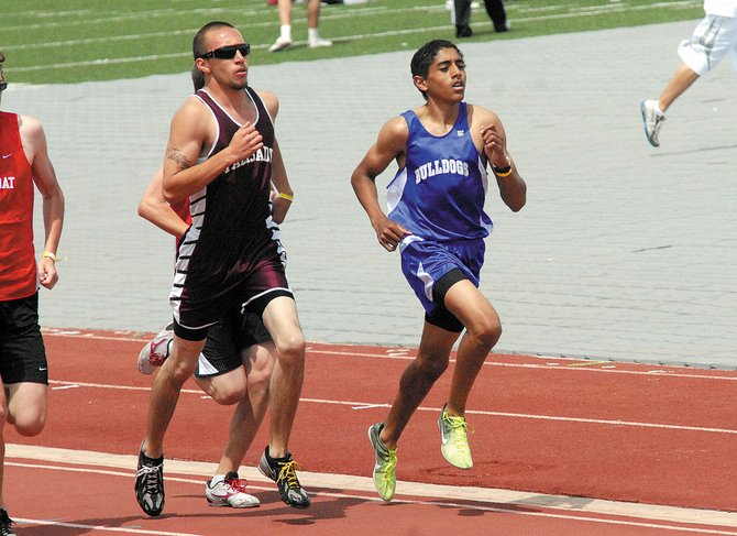 Alfredo Lebron, right, runs the 3200-meters during the Friday league championships in Grand Junction. The MCHS boys varsity track and field team tied for first in the league with Glenwood Springs.