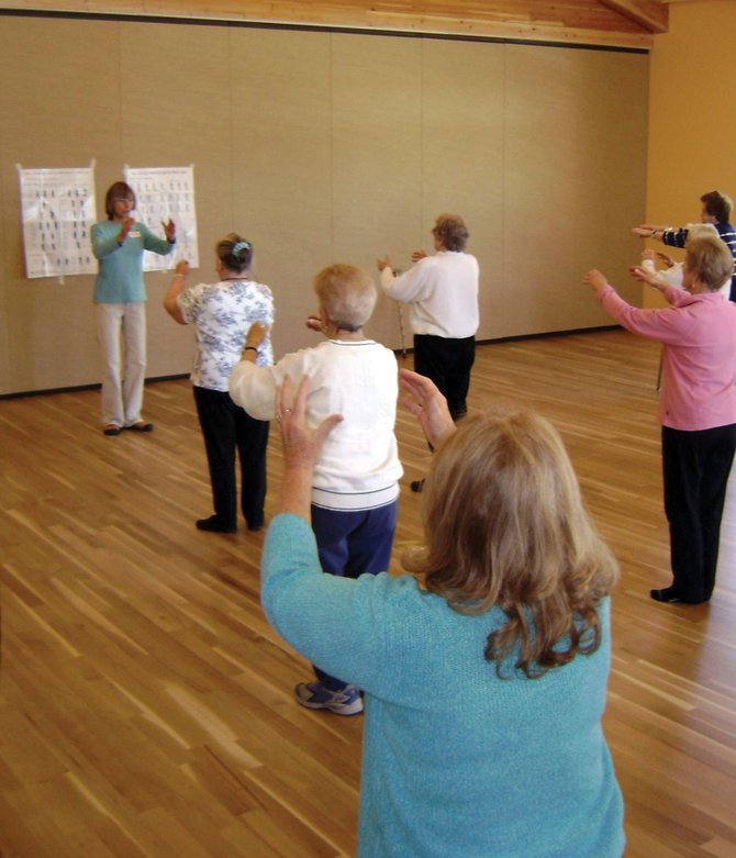 Aging Well fitness instructor Molly McClure leads older adults through a tai chi class at the Steamboat Springs Community Center. Tai chi and other Aging Well classes provide safe, yet challenging fitness options for individuals coping with arthritis.