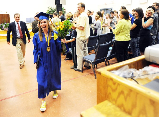 Hannah Zwak walks away from the stage at the Christian Heritage School in Steamboat Springs on Sunday afternoon. She was the school's only senior this year and the focus of the 1 hour, 15 minute graduation ceremony.