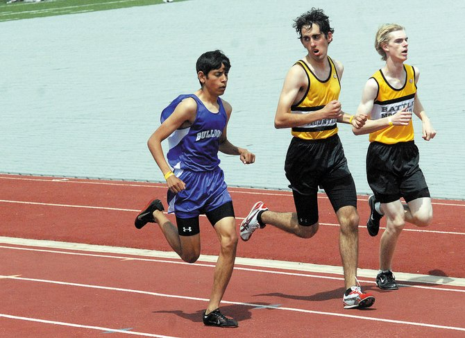 Johnny Landa, left, prepares to pass two Battle Mountain High School runners during the May 14 Western Slope League championships in Grand Junction. Landa, a sophomore, will be one of seven individual MCHS qualifiers competing at the state meet Thursday through Saturday in Lakewood.