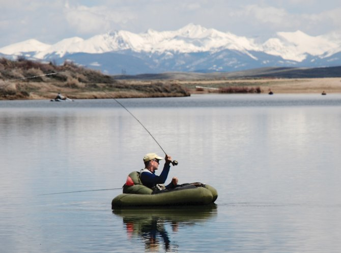 Jim Comeau fishes North Park's South Delaney Buttes Lake on Sunday with the Never Summer Range in the background.