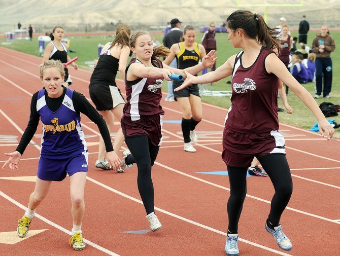 Soroco's Lauryn Bruggink hands the baton off to Ceanna Rossi in the 1,600-meter relay at a meet May 8. The team of Josie Rossi, Ceanna Rossi, Carmen Matthews and Bruggink will attempt to bring home a state championship from the state track meet that runs today through Saturday at Jeffco Stadium in Lakewood.