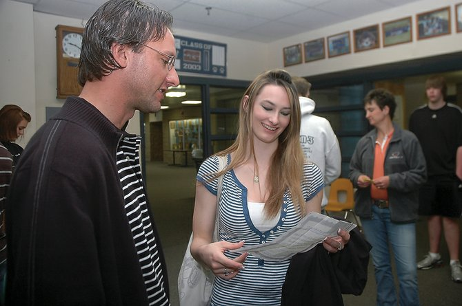George Avgares, left, director of Colorado Student Care, talks Wednesday morning with Jordan Porter, a Moffat County High School junior, about a college preparatory package she won in a drawing. Porter was entered in the drawing because she was wearing her seatbelt when stopped by the Craig Police Department. Officers gave out 207 certificates to students who wore their seatbelts in the 2009-10 school year as part of the Seatbelt Awareness Program.