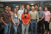 Moffat County High School students, Craig Police Department officials and local business owners and representatives gathered at the high school Wednesday to recognize winners in the 2009-10 Seatbelt Awareness Program. Shown above, front row, from left, are Manuel Tarango, Jordan Porter, Zaide Duarte, Tim Bohne, Bryan Gonzales and Dixie Beck. In the back row, from left, are Jamie Eckroth, Dylon Camilletti, Cody Adams, Tony St. John and George Avgares.