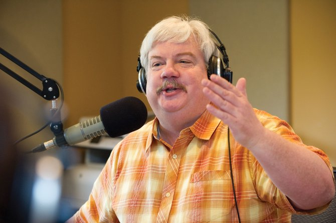 Rob Douglas talks while broadcasting the Cari and Rob Show on Tuesday morning from a studio on Yampa Street. The show, which features Douglas and Cari Hermacinski, has garnered state and national attention after Ken Buck made a controversial statement on the show.