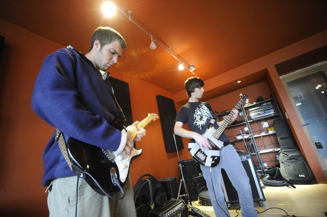 Steamboat Springs High School senior Connor Birch, left, and junior Carlo Gavatorta rehearse Wednesday in preparation for the seventh annual Teen Battle of the Bands at 9 p.m. Friday at The Steamboat Grand. Admission is $5.
