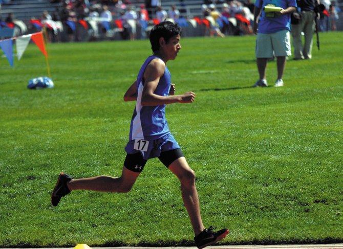 Sophomore Johnny Landa runs during the 3,200-meters Friday at the state track and field meet in Lakewood. Landa finished 14th in the event with a time of 10 minutes and 14.66 seconds.