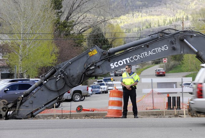 Steamboat Springs Police Department officer Sam Silva directs traffic Friday at Fifth Street and Lincoln Avenue.