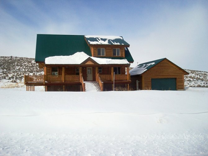 This four-bedroom, 3.5-bath log home in Stagecoach was reclaimed in foreclosure Wednesday by Chase Home Finance, which had submitted a price-setting bid of just less than $350,000 to the public trustee. The home sold for $695,000 in August 2007.