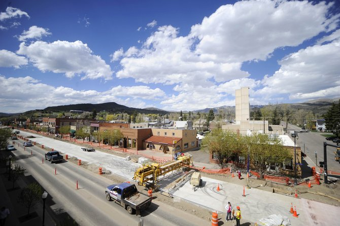 Work on repaving U.S. Highway 40 is about 3 1/2 weeks behind schedule, and city officials are considering paying overtime hours to help speed up the work.