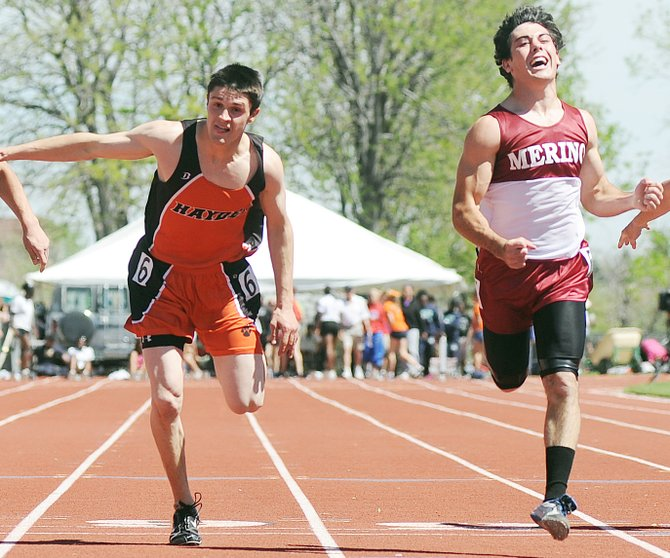 Hayden senior Jake Walker lunges across the finish line to finish second in the 100-meter dash at the state track meet in Lakewood. Walker finished 0.04 seconds behind the winner.