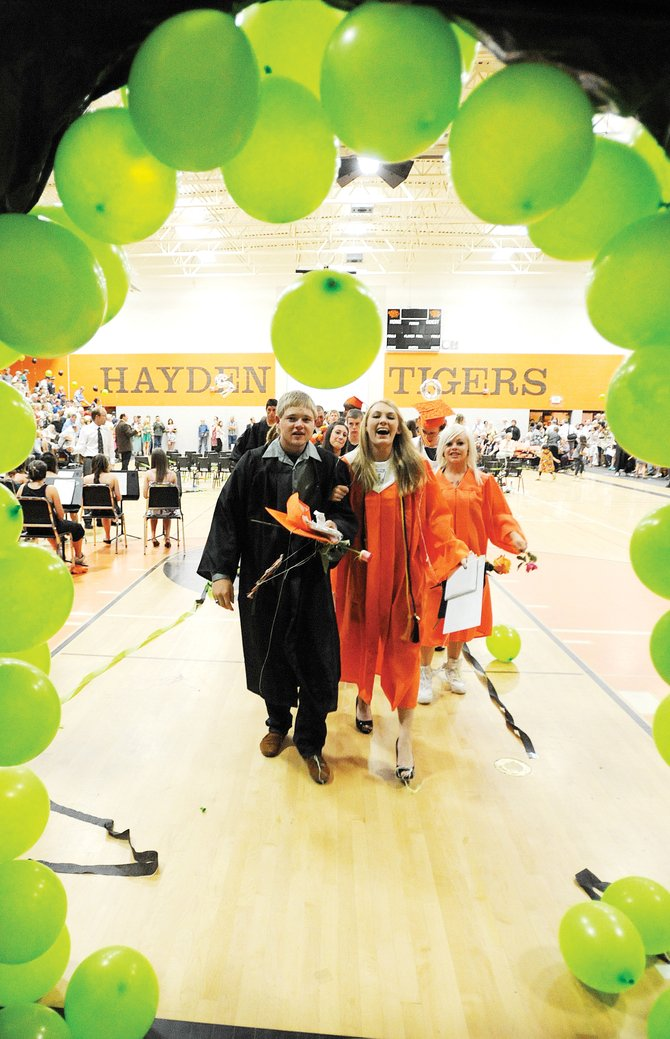 Kyle Barrett and Brittany Turner lead the Hayden High School Class of 2010 out of the school's gymnasium Sunday after the graduation ceremony.