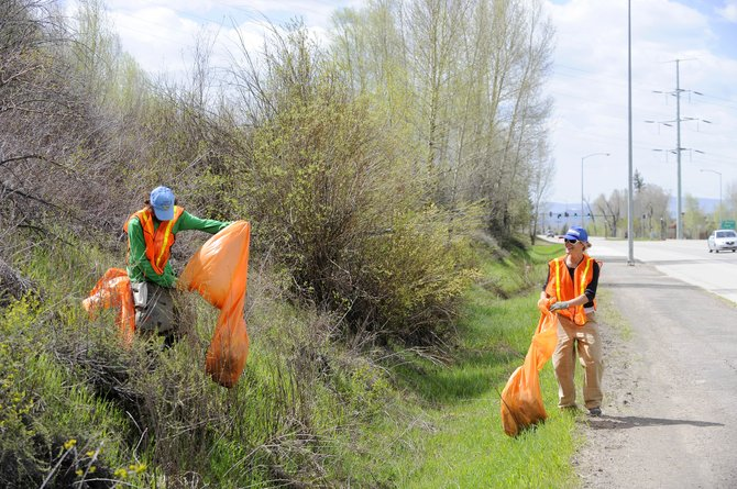 Scott Nielsen and Sarah Coleman pick up trash Saturday along U.S. Highway 40 in Steamboat Springs during Highway Clean-Up Day, which was part of belated Earth Day celebrations.