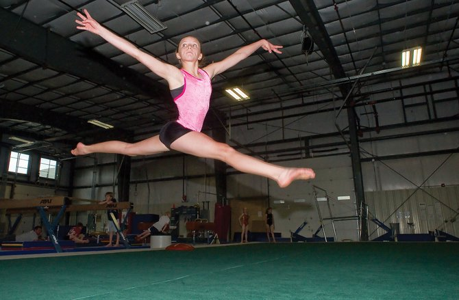 Steamboat Springs' gymnasts Maggie McElhiney performs a leap while practicing for this weekend's EAGLES league meet at Excel Gymnastics. The meet will provide a rare opportunity for McElhiney and her teammates to compete at home.