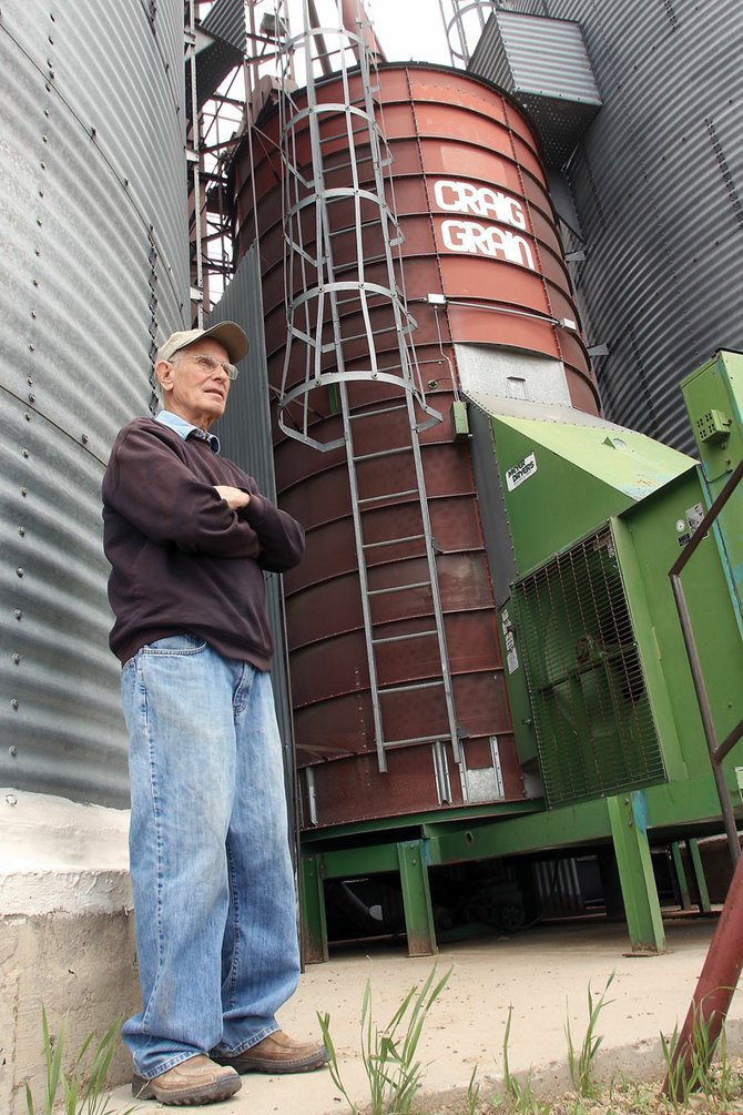Gordon Grandbouche, owner of Craig Grain Company, leans against a bin Wednesday at his business. After 43 years of operation, Grandbouche will close his doors and retire July 1. The timing, he said, is right for him to call it a career.