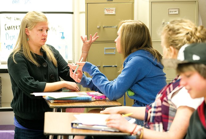 Steamboat Springs High School teacher Kelly Erickson talks with students in her freshman civics class Tuesday afternoon.