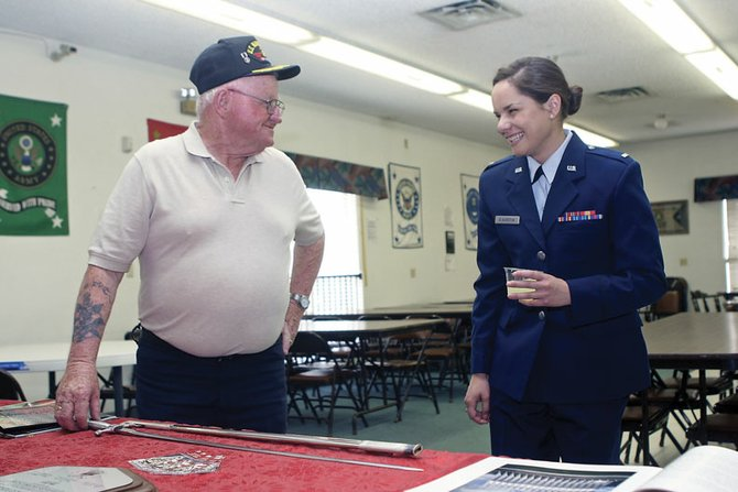 Jim Meineke and Maggie Blackstun share a laugh while looking at memorabilia from Blackstun's graduation from the United States Air Force Academy during a reception Friday at Veterans of Foreign Wars Post 4265. Blackstun is also a member of the Augusta Wallihan Chapter of the Daughters of the American Revolution.