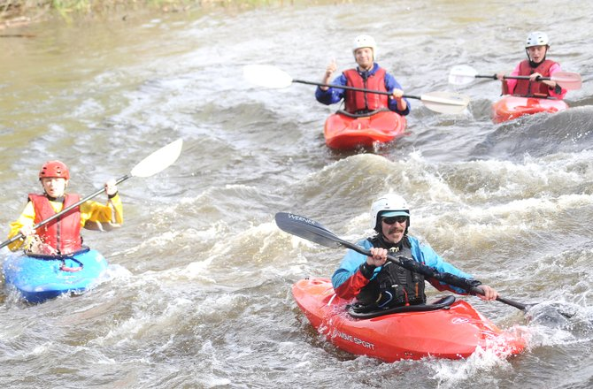 Barry Smith leads a class of beginner kayakers down the Yampa River on Friday. The Mountain Sports Kayak School offers three- and four-day classes for rookies.