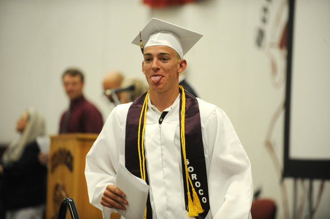 Cody Miles sticks his tongue out for a camera after receiving his diploma Saturday at Soroco High School.