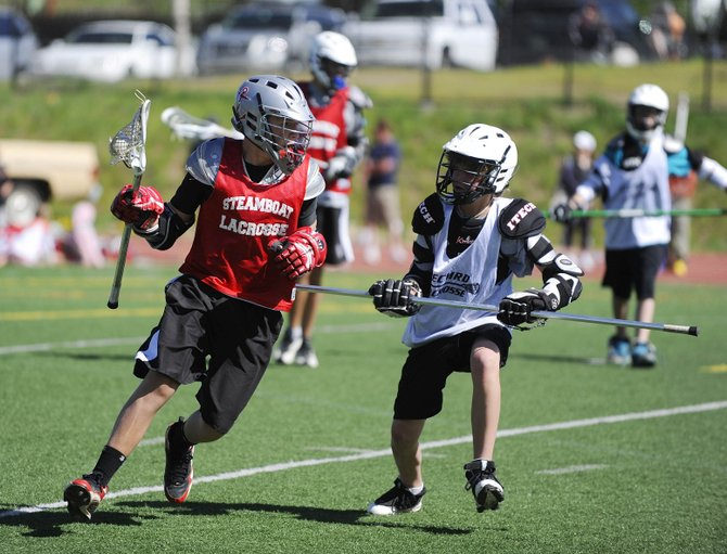 Ben Wharton works the ball around Saturday at the Steamboat Classic Lacrosse Tournament. Wharton and fellow eighth-grader Peter White have been key cogs in the Steamboat Youth Lacrosse program and for the eighth-grade team this year.