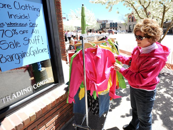 Donna Moore, of Tulsa, Okla., browses Sunday in front of Moose Mountain Trading Co. in downtown Steamboat Springs.