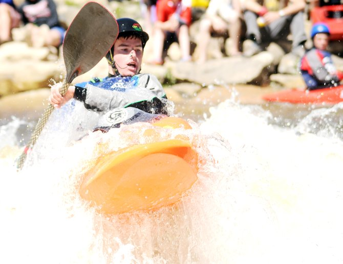 Luke Farny paddles Sunday in the juniors rodeo during the Yampa River Festival. He tied for first place in the event with Karsten Thompson. The professionals hit the waves today for the Paddling Life Pro Invitational, which starts at 10 a.m. with a dash down Fish Creek. The freestyle portion of the event will start at 1 p.m. at Charlie's Hole.
