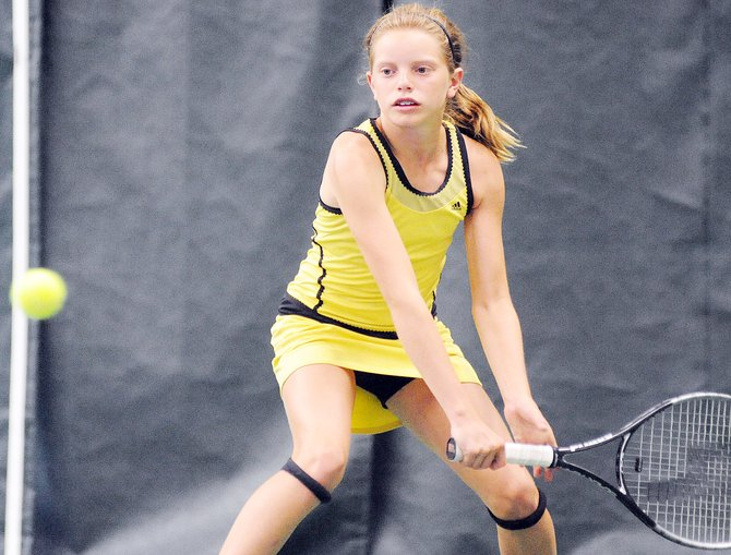 Tate Schroeder, of Lone Tree, eyes the ball Sunday during a tournament at the Tennis Center in Steamboat Springs. She was a part of the championship doubles team and will play again today in the singles finals of the 12-and-younger circuit championships.