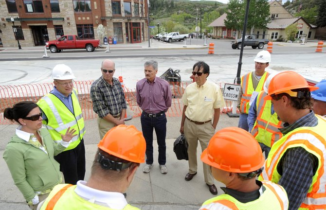 Local officials, from left, Steamboat Springs City Council President Cari Hermacinski, Public Works Director Philo Shelton, City Manager Jon Roberts, state Sen. Al White and Colorado Transportation Commissioner George Krawzoff meet with Scott Contracting and Colorado Department of Transportation officials Tuesday at 10th Street and Lincoln Avenue to discuss the downtown repaving project.
