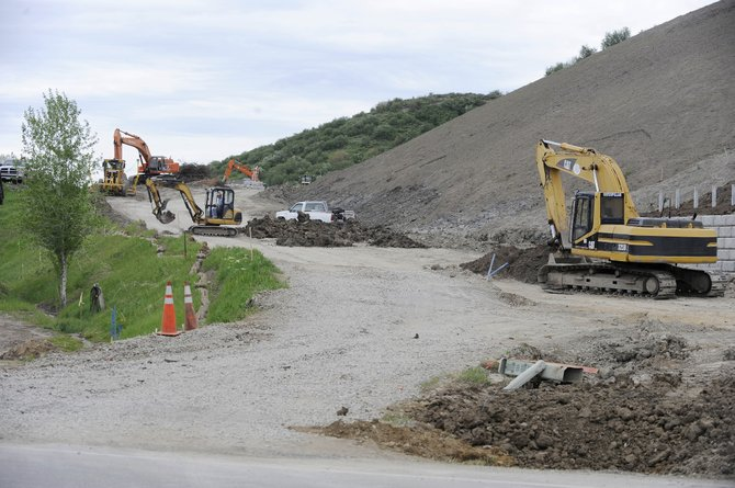 Work continues Thursday on the construction of Gossard Parkway off Downhill Drive in Steamboat Springs. City officials gave initial approval Tuesday to an agreement with neighboring Johnson Excavation. Lawsuits related to the parkway still are pending in the Colorado Court of Appeals.