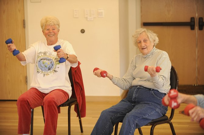 Seniors Margrit Kipfer, left, and Nancy Howell participate in Susan Shoemaker's Aging Well exercise class May 13. Many older residents surveyed recently said they would need more housing options to stay in the Yampa Valley long term.