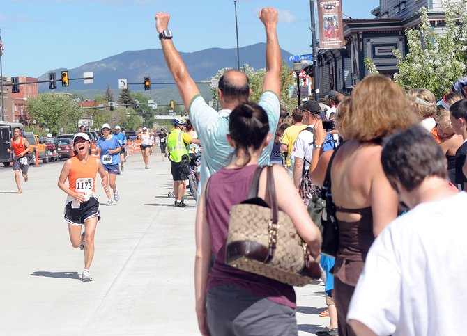 Mako Shimoda of Longmont closes in on the finish of the Steamboat Marathon as friends, family and fans of all the runners celebrate on the sidewalk. Downtown businesses hope the Lincoln Avenue sidewalks stay full throughout the summer. Officials say the appetite for close-in vacations could lead to increased visitorship from Front Range residents like Shimoda, and local marketing efforts are being geared toward them.
